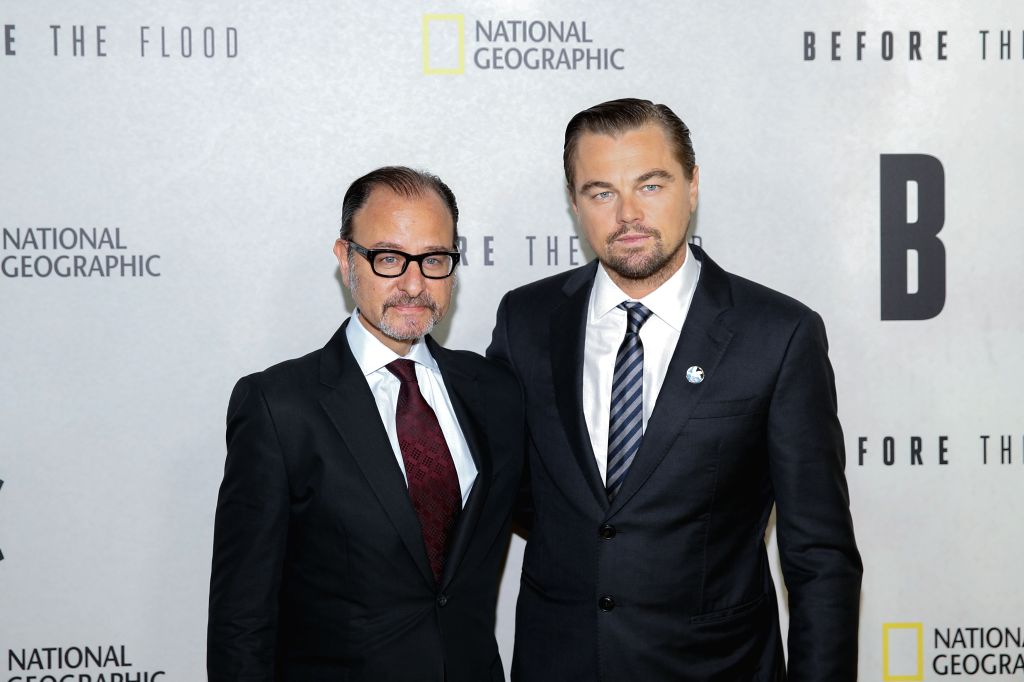 NEW YORK, Oct. 21, 2016 - United Nations Messenger of Peace Leonardo DiCaprio (R) poses for a photo with producer Fisher Stevens during a special screening of a new climate change documentary ...
