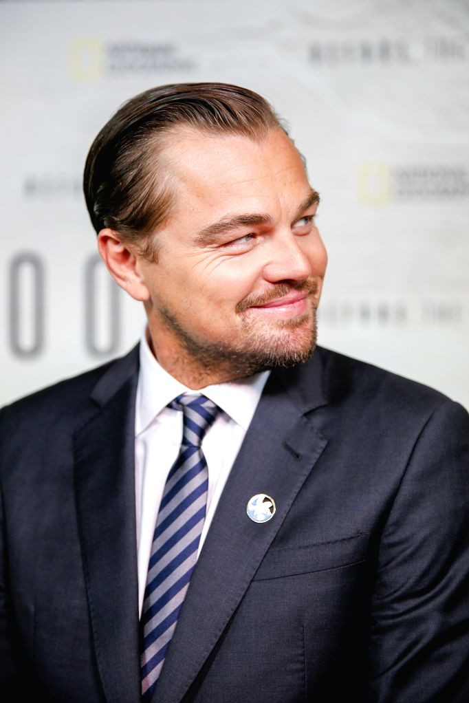 "NEW YORK, Oct. 21, 2016 - United Nations Messenger of Peace Leonardo DiCaprio poses for a photo during a special screening of a new climate change documentary ""Before the Flood"", at the UN ..."