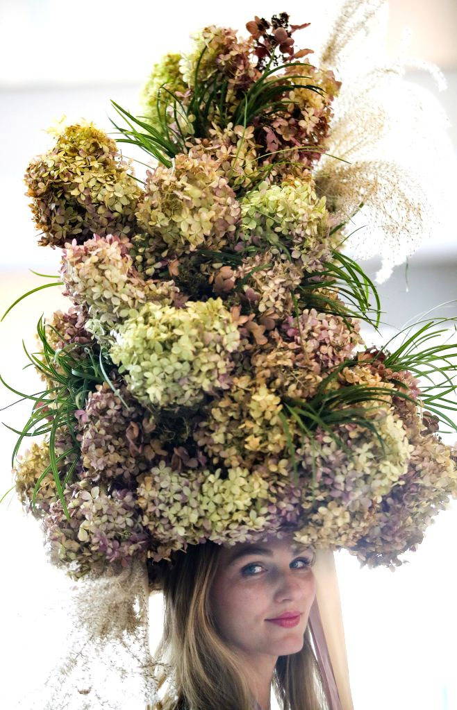 NEW YORK, Oct. 25, 2019 - A model with floral headpiece is seen at a floral exhibition at the Shops and Restaurants at Hudson Yards in New York, the United States, Oct. 25, 2019. A collection of 14 ...