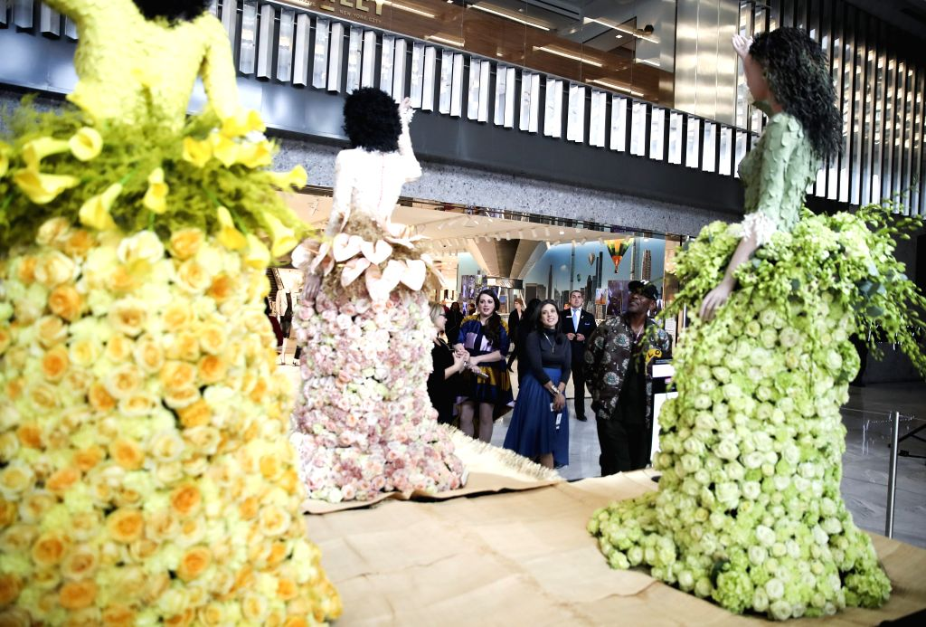NEW YORK, Oct. 25, 2019 - People view mannequins with fresh-floral fashion at the Shops and Restaurants at Hudson Yards in New York, the United States, Oct. 25, 2019. A collection of 14 floral ...