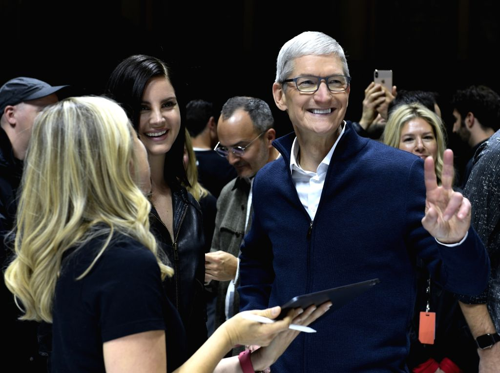 NEW YORK, Oct. 30, 2018 (Xinhua) -- Apple CEO Tim Cook (R, Front) gestures during an event to unveil new Apple products in Brooklyn, New York, the United States, on Oct. 30, 2018. Apple Inc. on Tuesday launched its new iPad Pro, MacBook Air and Mac m