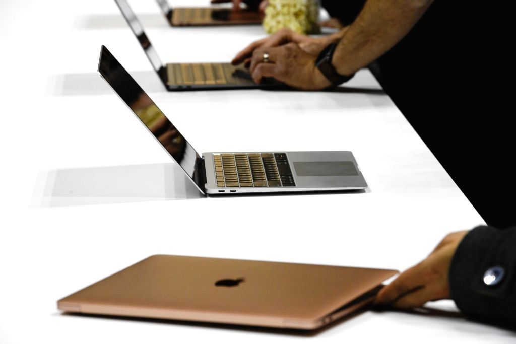NEW YORK, Oct. 30, 2018 (Xinhua) -- Photo taken on Oct. 30, 2018 shows Apple products during a launch event in Brooklyn, New York, the United States. Apple Inc. on Tuesday launched its new iPad Pro, MacBook Air and Mac mini at an event in Brooklyn, N