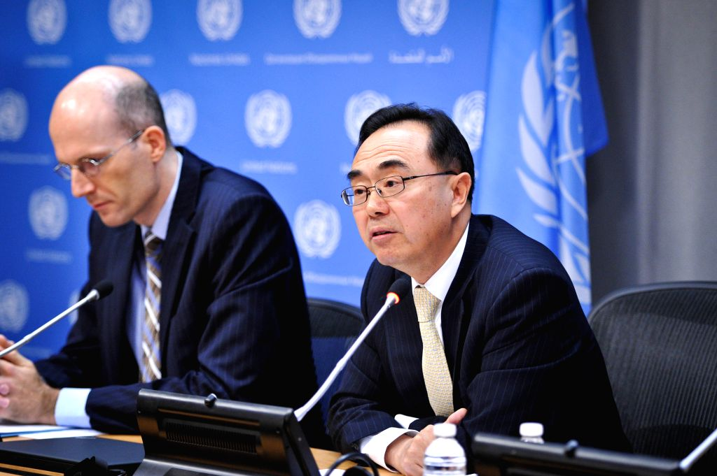 New York: Pingfan Hong(R), Director of the Development and Policy Analysis Division for the UN Department of Economic and Social Affairs, speaks during a press conference to preview the World ...