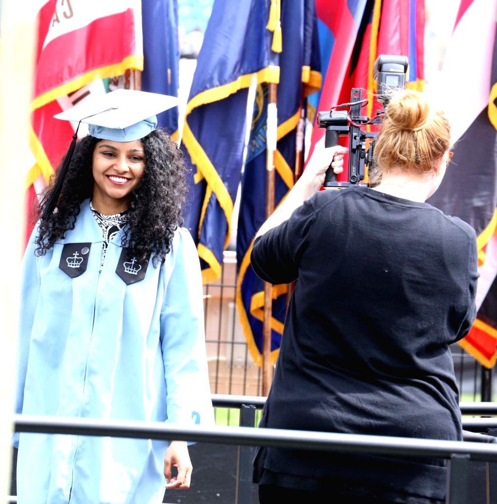New York: Pratishta Yerakala being photographed by her mother during 2017 Graduation Ceremony of Columbia University in New York on May 16, 2017.