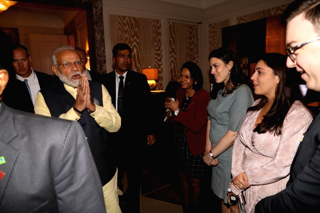 New York: Prime Minister Narendra Modi greets people on his arrival at the Lotte New York Palace in New York, USA on Sep 22, 2019. - Narendra Modi