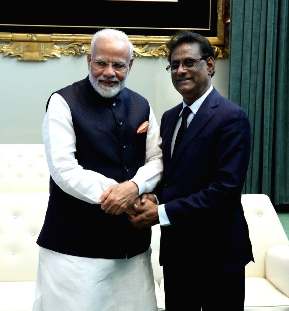 New York: Prime Minister Narendra Modi meets Mauritius President Barlen Vyapoory, in New York on Sep 27, 2019. - Narendra Modi