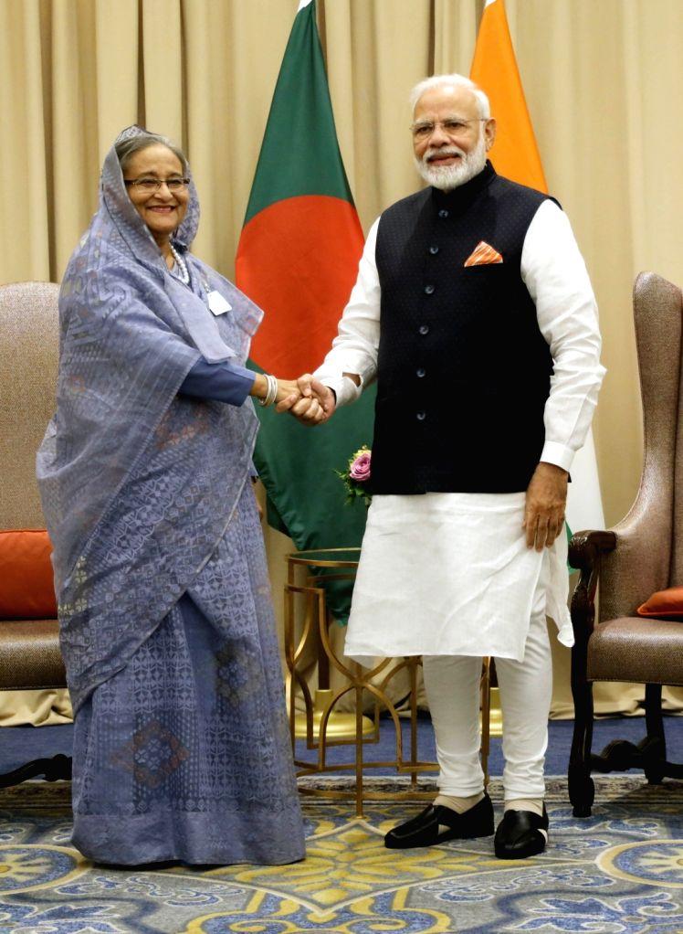 New York: Prime Minister Narendra Modi meets his Bangladeshi counterpart Sheikh Hasina, in New York on Sep 27, 2019. - Narendra Modi