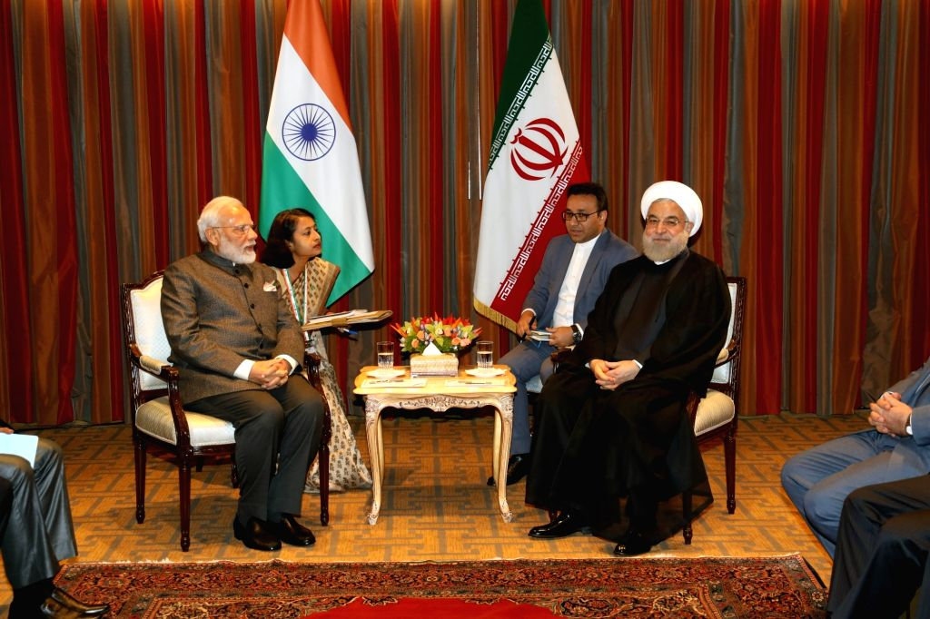 New York: Prime Minister Narendra Modi meets Iranian President Hassan Rouhani in New York on Sep 26, 2019. (Photo: Mohammed Jaffer/IANS) - Narendra Modi and Hassan Rouhani