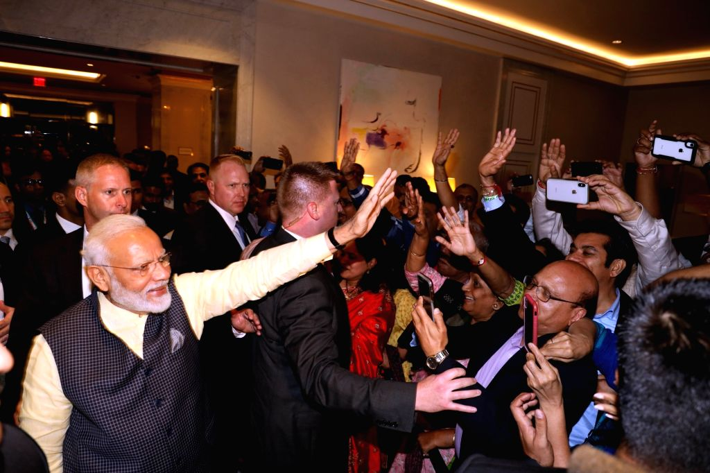 New York: Prime Minister Narendra Modi waves at supporters on his arrival at the Lotte New York Palace in New York, USA on Sep 22, 2019. - Narendra Modi