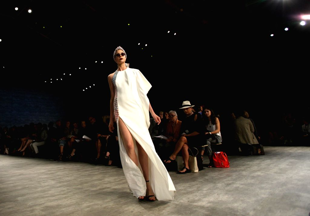 A model presents a creation of the Spring/Summer 2015 BIBHU MOHAPATRA collection during the New York Fashion Week in New York, the United States, on Sept. 10, ...