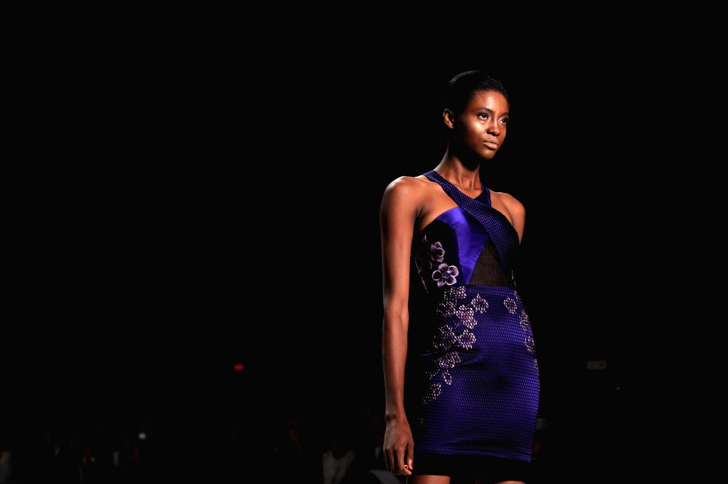 A model presents a creation of the Spring/Summer 2015 CLAN collection during the New York Fashion Week in New York, the United States, on Sept. 10, 2014. ...