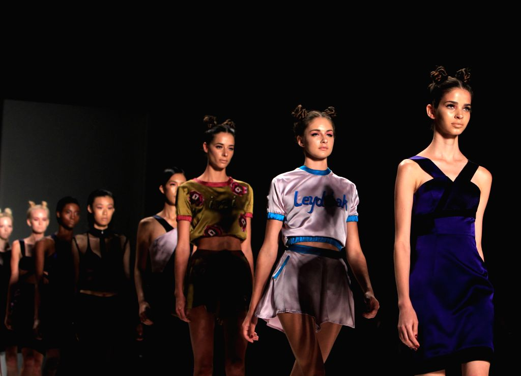 Model present creations of the Spring/Summer 2015 DEOLA SAGOE collection during the New York Fashion Week in New York, the United States, on Sept. 10, 2014. ...