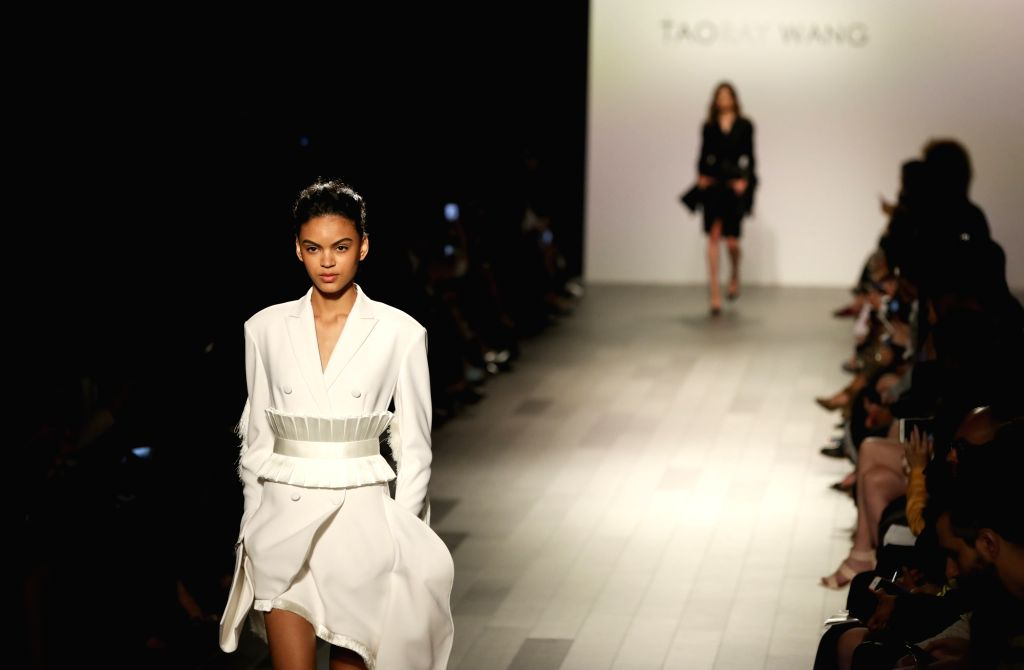 NEW YORK, Sept. 10, 2017 - Models present creations of the Spring/Summer 2018 Taoray Wang collection during the New York Fashion Week in New York, the United States on Sept. 9, 2017.