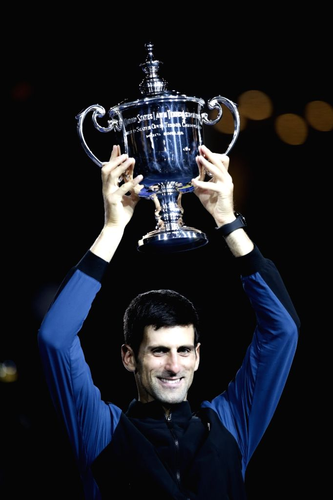 NEW YORK, Sept. 10, 2018 - Novak Djokovic of Serbia celebrates with his trophy during the awarding ceremony for the men's singles at the 2018 US Open tennis championships in New York, the United ...
