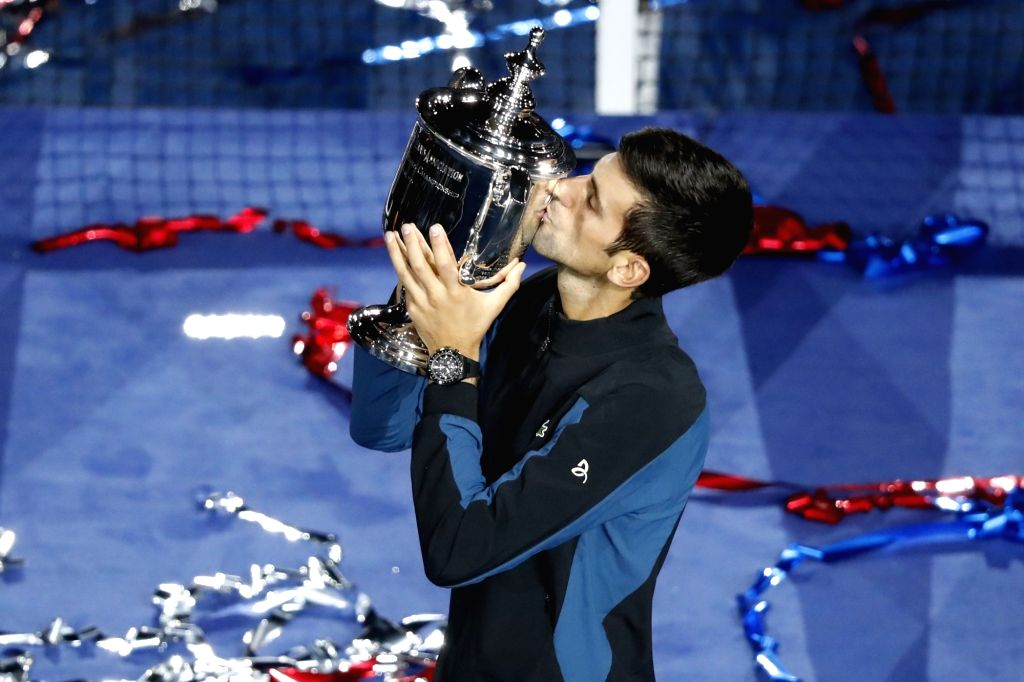 NEW YORK, Sept. 10, 2018 - Novak Djokovic of Serbia kisses his trophy during the awarding ceremony for the men's singles at the 2018 US Open tennis championships in New York, the United States, Sept. ...