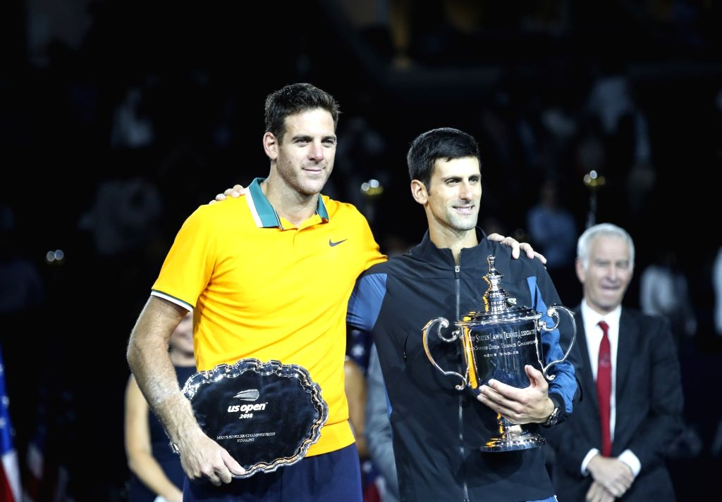 NEW YORK, Sept. 10, 2018 - Novak Djokovic (R) of Serbia and Juan Martin del Potro of Argentina pose for photo during the awarding ceremony after their men's singles final match at the 2018 US Open ...