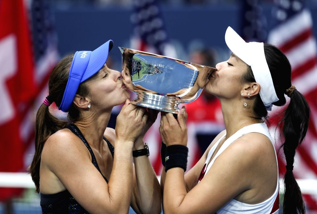 NEW YORK, Sept. 11, 2017 - Yung-Jan Chan (R) of Chinese Taipei and Martina Hingis of Switzerland kiss the trophy during the awarding ceremony of the women's doubles match at the 2017 US Open in New ... - Martina Hingis