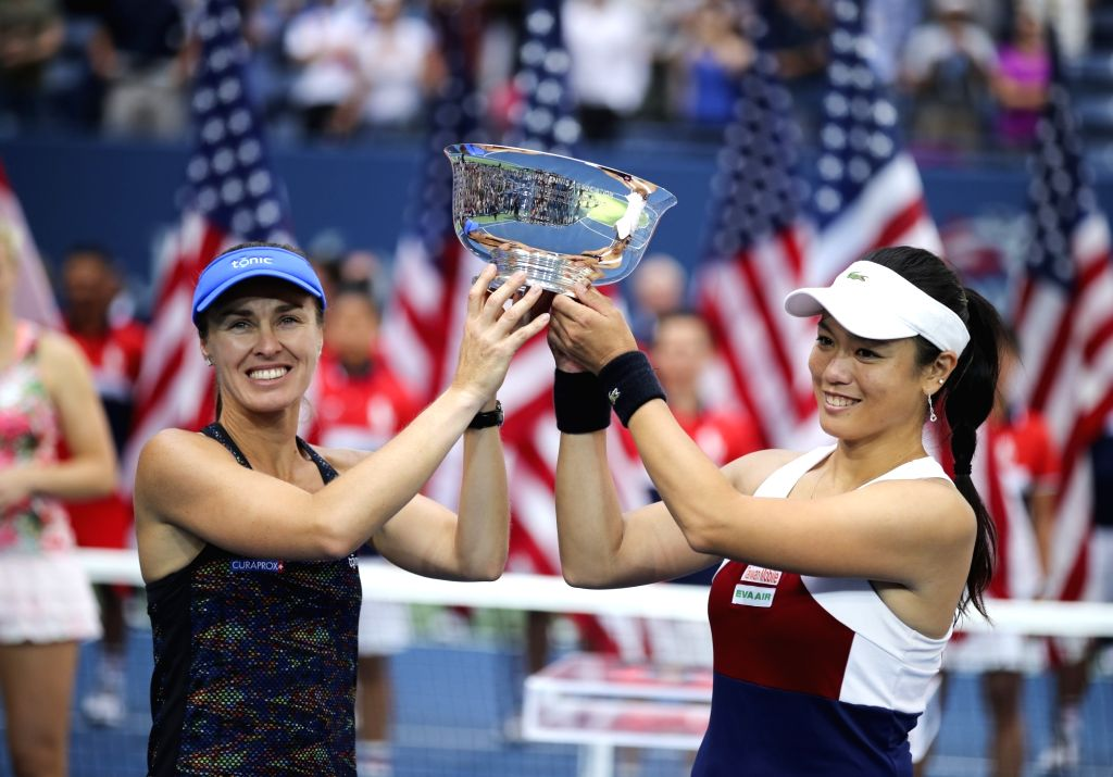 NEW YORK, Sept. 11, 2017 - Yung-Jan Chan (R) of Chinese Taipei and Martina Hingis of Switzerland hold the trophy during the awarding ceremony of the women's doubles match at the 2017 US Open in New ... - Martina Hingis