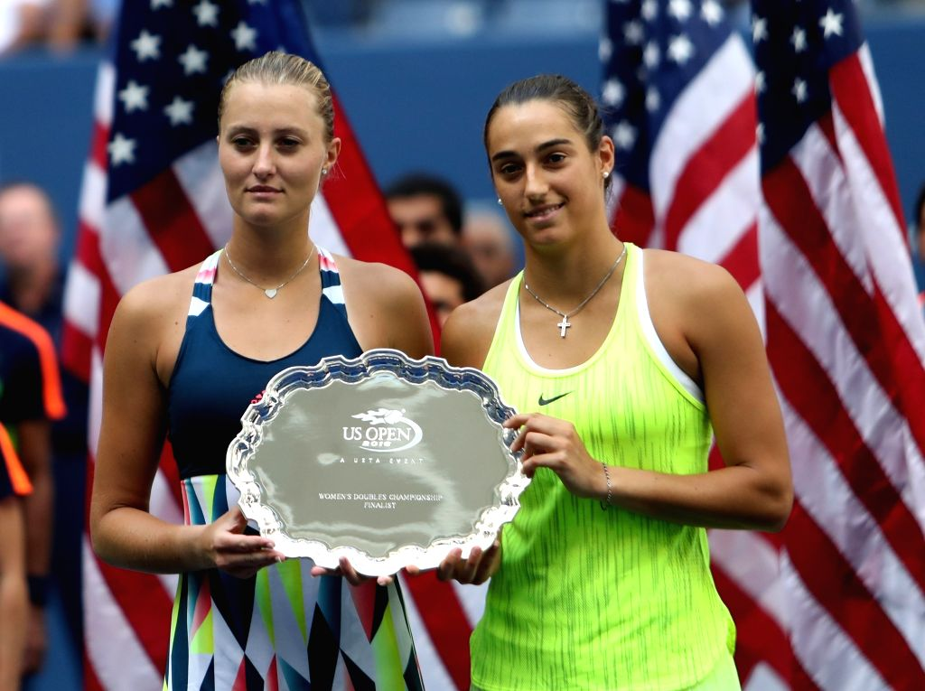 NEW YORK, Sept. 12, 2016 - France's Kristina Mladenovic (L) and Caroline Garcia pose for photos during the awarding ceremony after the women's doubles final match against Lucie Safarova of the Czech ...