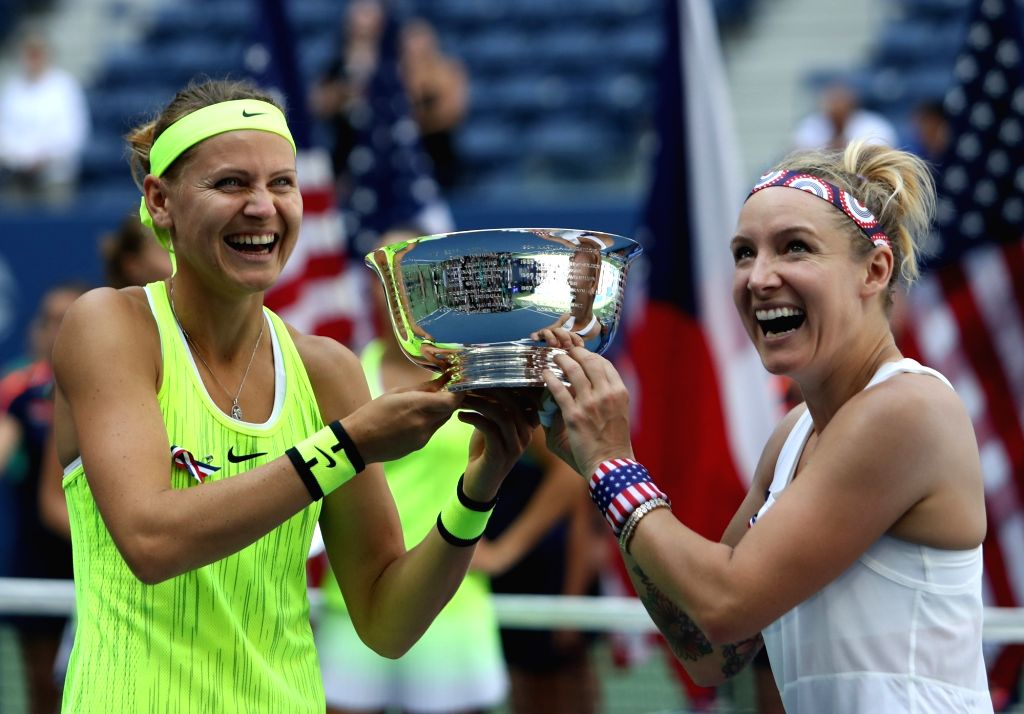 NEW YORK, Sept. 12, 2016 - Lucie Safarova (L) of the Czech Republic and Bethanie Mattek-Sands of the United States celebrate during the awarding ceremony after the women's doubles final match against ...