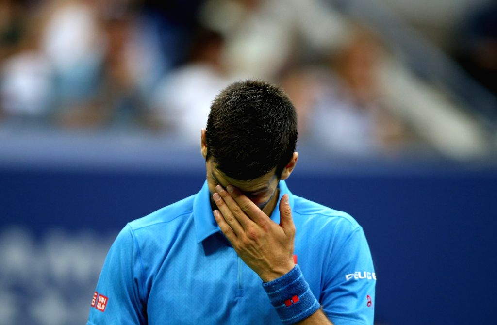 NEW YORK, Sept. 12, 2016 - Novak Djokovic of Serbia reacts during the men's singles final match against Stan Wawrinka of Switzerland at the 2016 U.S. Open in New York, the United States, Sept. 11, ...