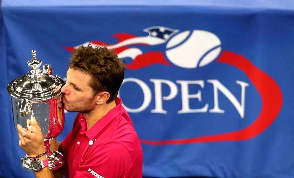 NEW YORK, Sept. 12, 2016 - Stan Wawrinka of Switzerland kisses the trophy during the awarding ceremony after the men's singles final match against Novak Djokovic of Serbia at the 2016 U.S. Open ...