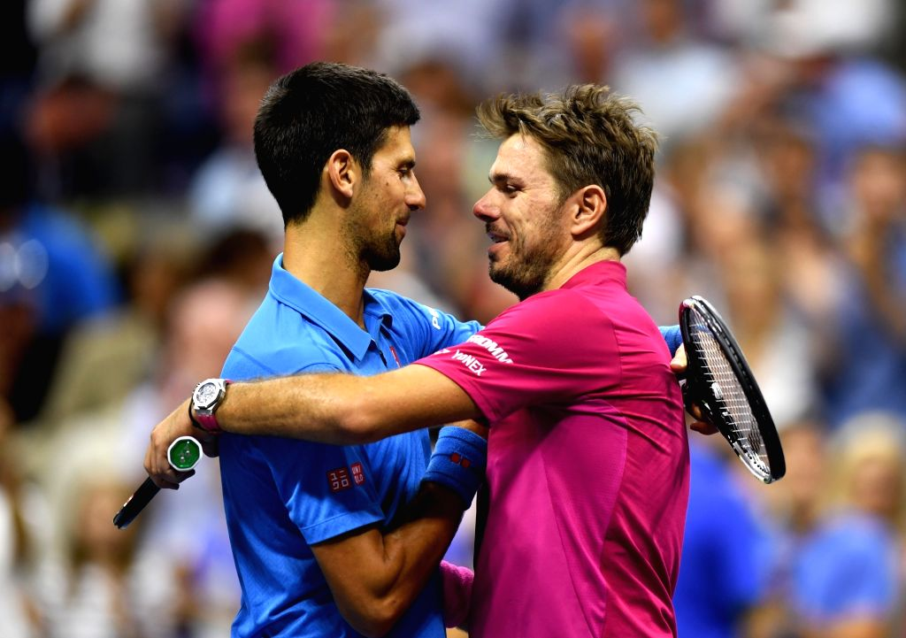 NEW YORK, Sept. 12, 2016 - Stan Wawrinka (R) of Switzerland hugs Novak Djokovic of Serbia after the men's singles final match at the 2016 U.S. Open tennis tournament in New York, the United States, ...