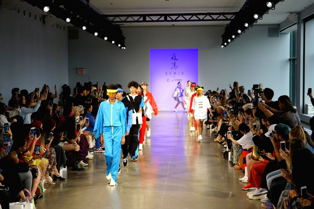 NEW YORK, Sept. 12, 2018 - Models present creations of Semir x CJ Yao Spring/Summer 2019 collection during the New York Fashion Week in New York, the United States, Sept. 12, 2018.