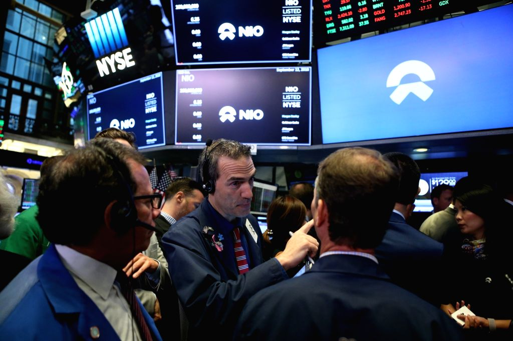 NEW YORK, Sept. 12, 2018 (Xinhua) -- Traders work at the New York Stock Exchange in New York, the United States, on Sept. 12, 2018. NIO Inc., a Chinese electric vehicle start-up, rang the New York Stock Exchange (NYSE) opening bell on Wednesday in ce