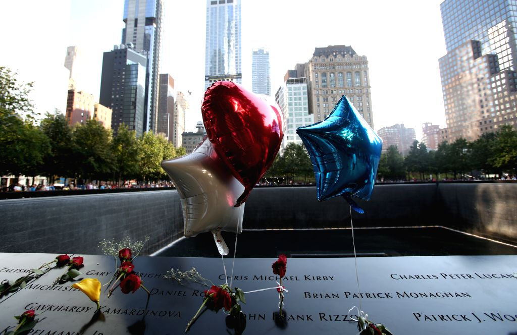 NEW YORK, Sept. 12, 2019 - Flowers and balloons are placed to mourn the victims of the 9/11 terror attacks at the National September 11 Memorial and Museum in New York, the United States, on Sept. ...