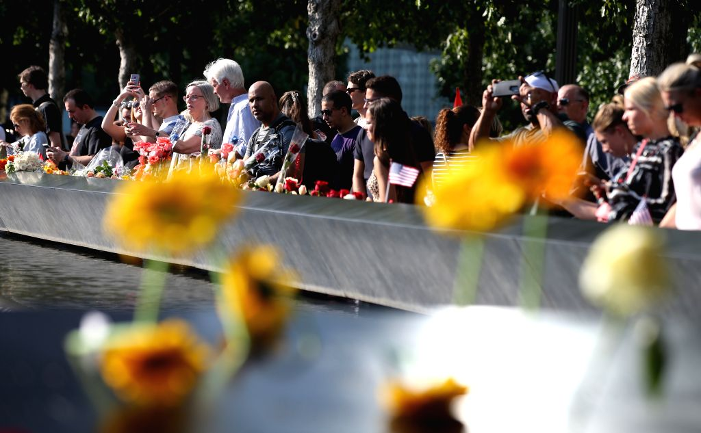 NEW YORK, Sept. 12, 2019 - People mourn the victims of the 9/11 terror attacks at the National September 11 Memorial and Museum in New York, the United States, Sept. 11, 2019. People paid their ...