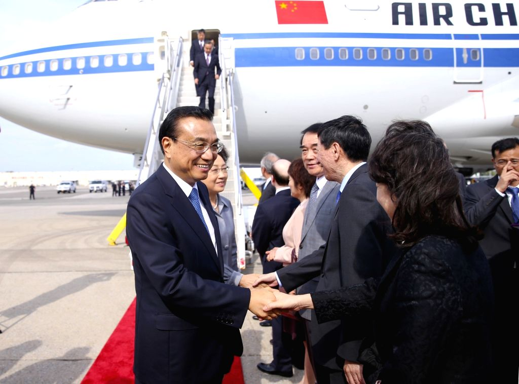 NEW YORK, Sept. 18, 2016 - Chinese Premier Li Keqiang (1st L) and his wife Cheng Hong (2nd L) arrive at John F. Kennedy International Airport in New York, the United States, Sept. 18, 2016. Premier ...