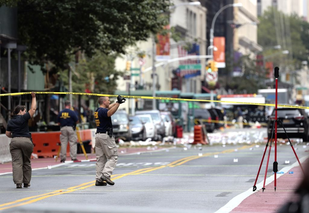 NEW YORK, Sept. 18, 2016 - FBI investigators are seen at the blast site in New York, U.S., Sept. 18, 2016. All 29 people wounded in Saturday's blast in New York City were released from hospitals, ...