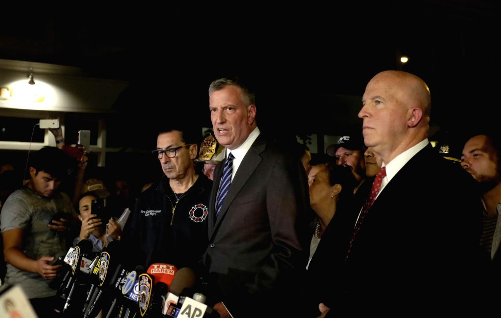 NEW YORK, Sept. 18, 2016 - New York City Mayor Bill de Blasio (front, C) gives a news conference as New York Police Department Commissioner James O'Neill (front, 1st R) stands aside near the blast ...