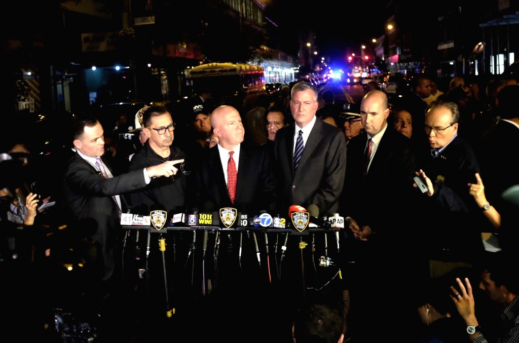 NEW YORK, Sept. 18, 2016 - New York Police Department Commissioner James O'Neill (3rd L) and New York City Mayor Bill de Blasio (3rd R) give a news conference near the blast site in New York, U.S., ...