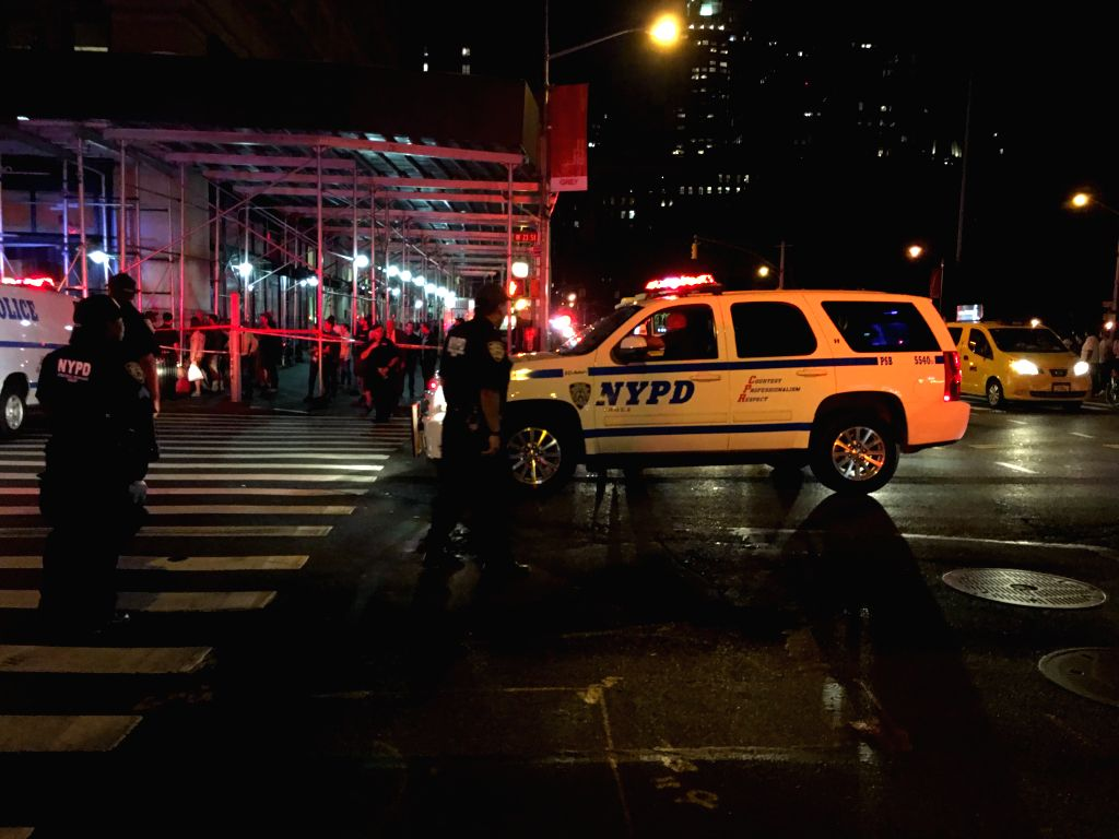NEW YORK, Sept. 18, 2016 - The cellphone photo taken on Sept. 17, 2016 shows policemen on duty near the site of an explosion in New York, the United States. A total of 25 people have been injured in ...
