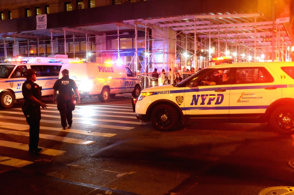 NEW YORK, Sept. 18, 2016 - The photo taken on Sept. 17, 2016 shows policemen on duty near the site of an explosion in New York, the United States. A total of 25 people have been injured in an ...