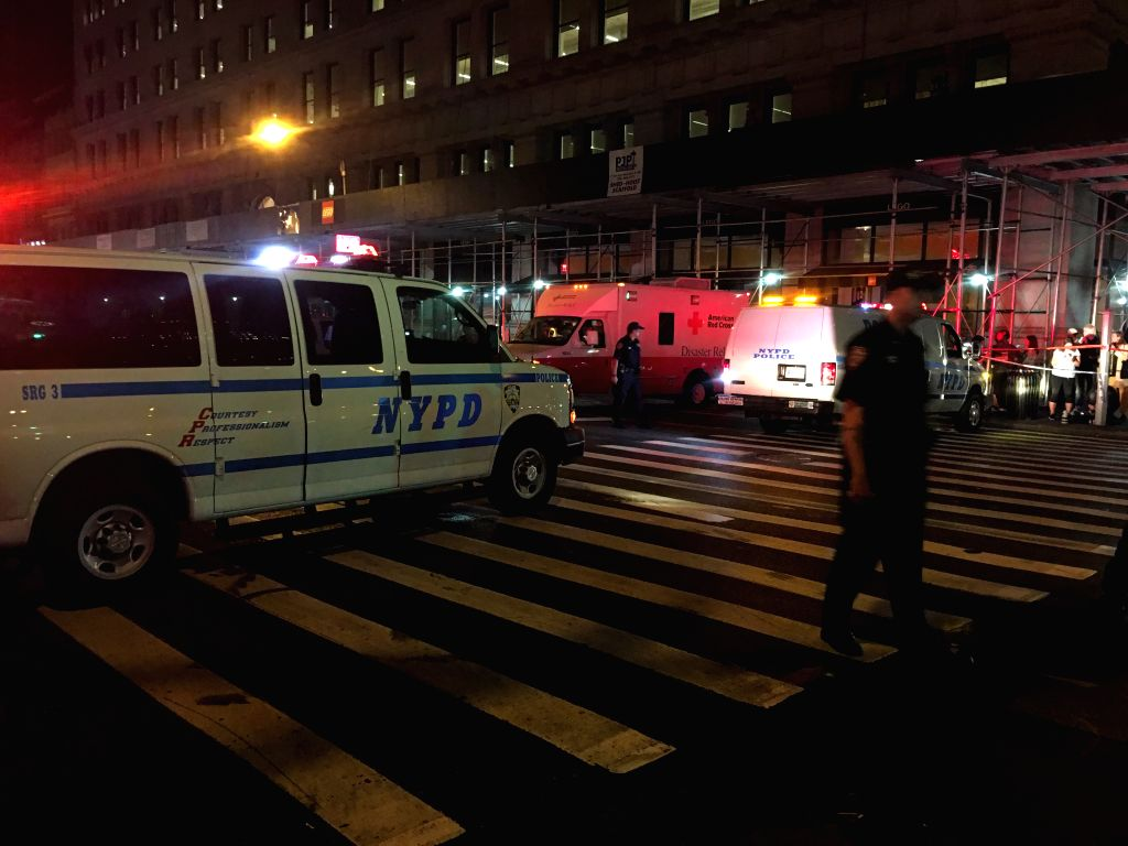 NEW YORK, Sept. 18, 2016 - This cellphone photo taken on Sept. 17, 2016 shows the police blocking a road after an explosion in New York, the United States. A total of 25 people have been injured in ...