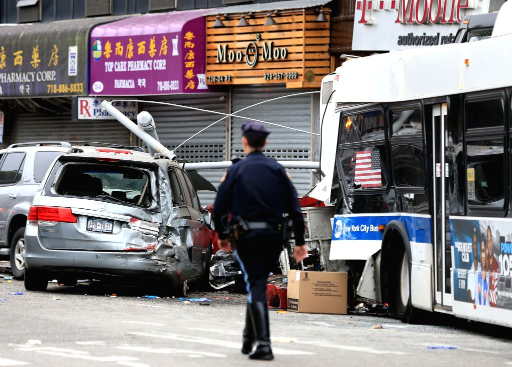 NEW YORK, Sept. 18, 2017 - Photo taken on Sept. 18, 2017 shows the site of buses collision in Flushing in the New York City borough of Queens, the United States. At least three people were confirmed ...