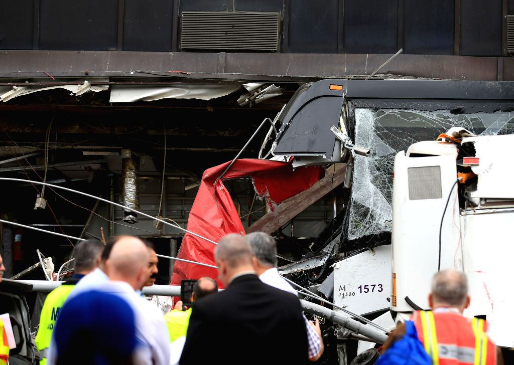NEW YORK, Sept. 18, 2017 - Rescuers work at the site of buses collision in Flushing in the New York City borough of Queens, the United States, on Sept. 18, 2017. At least three people were confirmed ...