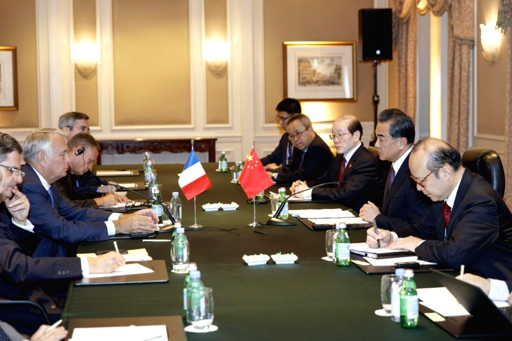 NEW YORK, Sept. 19, 2016 - Chinese Foreign Minister Wang Yi(2nd R) meets with his French counterpart Jean-Marc Ayrault(2nd L) in New York, the United States on Sept. 19, 2016. - Wang Y