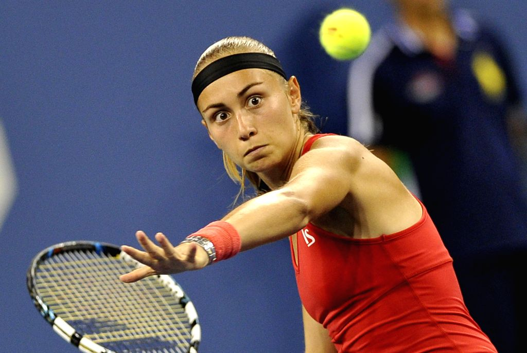 Aleksandra Krunic of Serbia hits a return during the women's single 4th round match against Victoria Azarenka of Belarus at the 2014 U.S. Open in New York, the ...