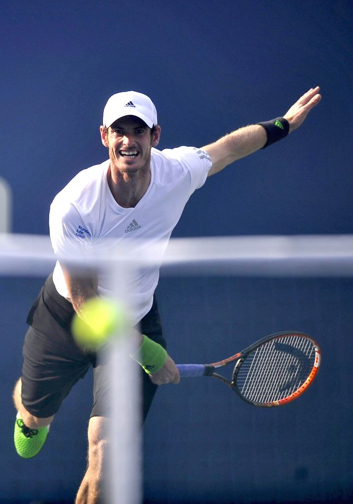 Andy Murray of Britain serves during the men's singles fourth round match against Jo-Wilfried Tsonga of France at the 2014 U.S. Open in New York, the United ...