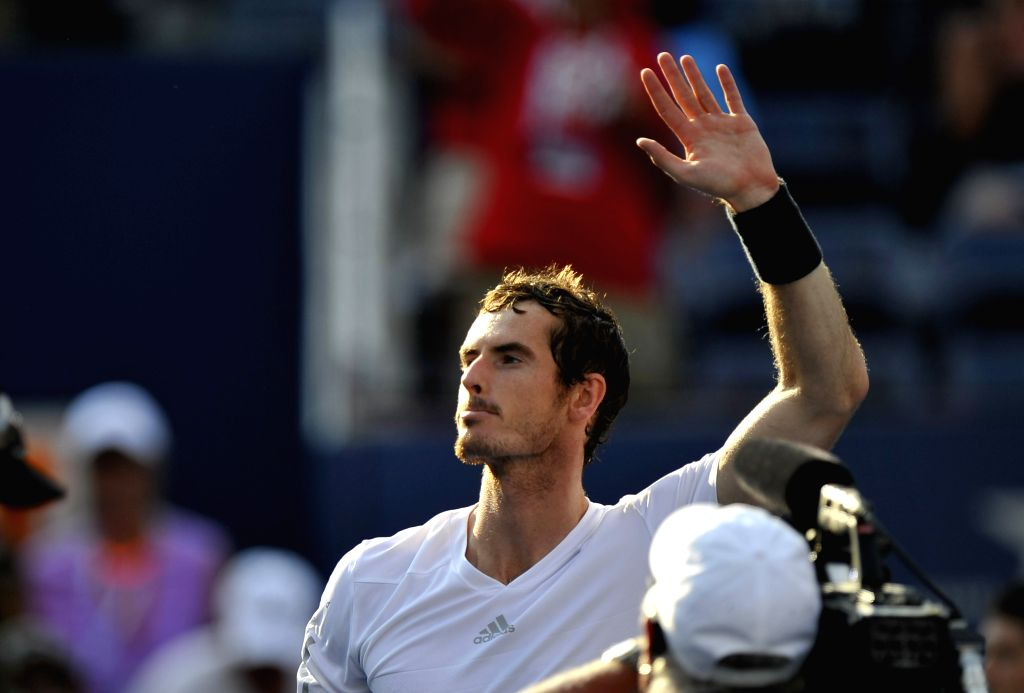Andy Murray of Britain gestures to the spectators after the men's singles fourth round match against Jo-Wilfried Tsonga of France at the 2014 U.S. Open in New ...