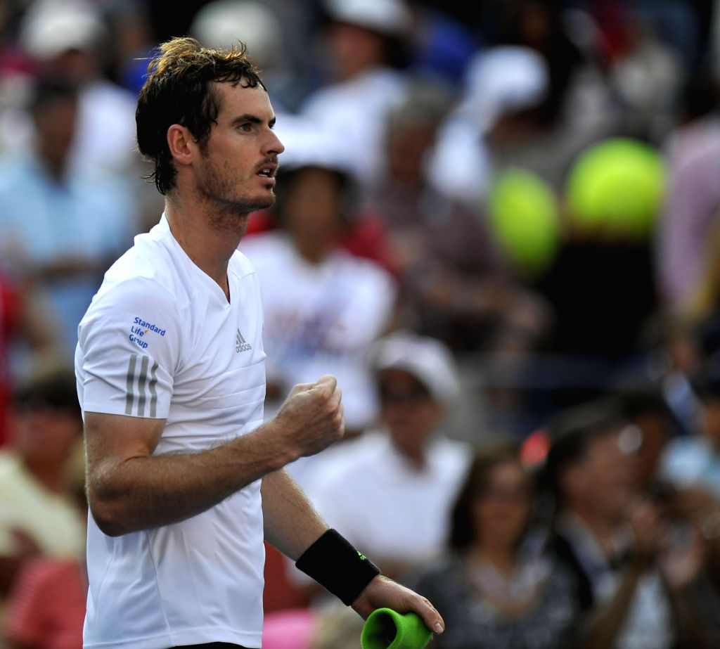 Andy Murray of Britain reacts during the men's singles fourth round match against Jo-Wilfried Tsonga of France at the 2014 U.S. Open in New York, the United ...