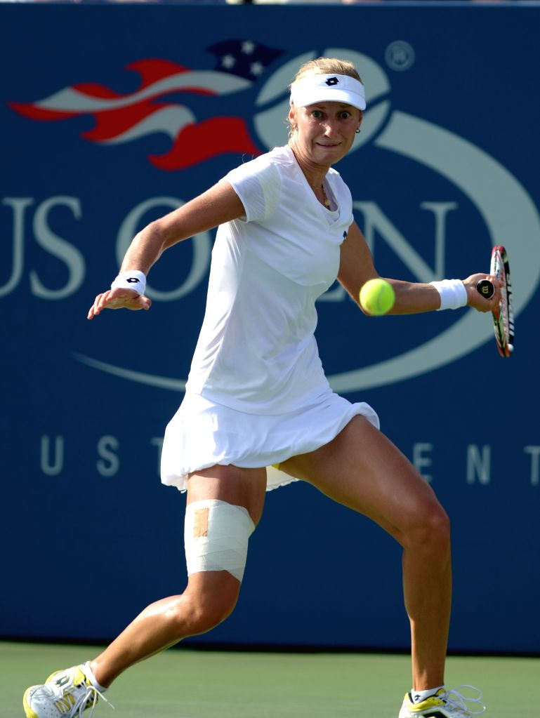 Ekaterina Makarova of Russia returns a shot during the women's singles fourth round match against Eugenie Bouchard of Canada at the 2014 U.S. Open in New York, the