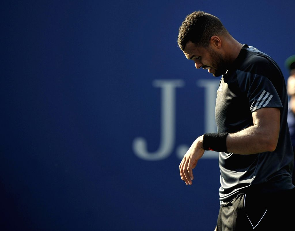 Jo-Wilfried Tsonga of France reacts during the men's singles fourth round match against Andy Murray of Britain at the 2014 U.S. Open in New York, the United ...