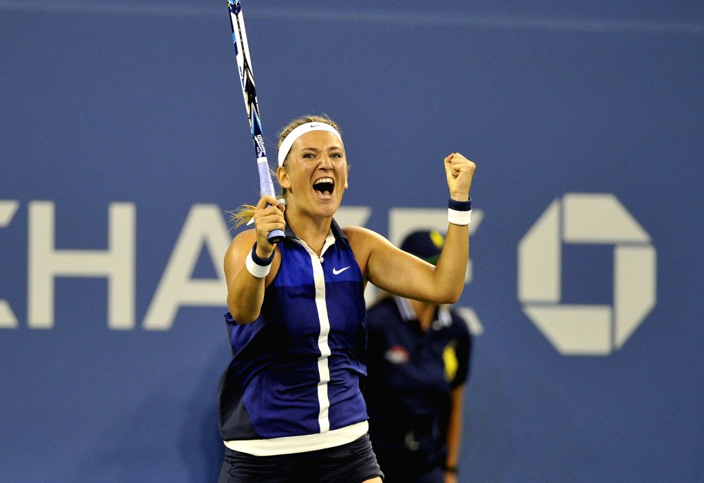 Victoria Azarenka of Belarus reacts after winning the women's single 4th round match against Aleksandra Krunic of Serbia at the 2014 U.S. Open in New York, the ...