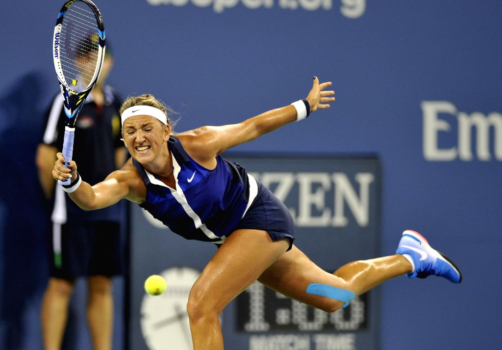 Victoria Azarenka of Belarus hits a return during the women's single 4th round match against Aleksandra Krunic of Serbia at the 2014 U.S. Open in New York, the ...