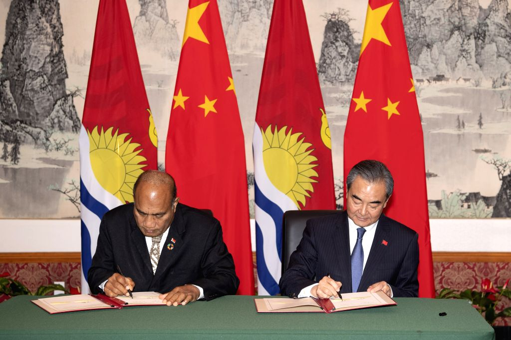 NEW YORK, Sept. 27, 2019 - Chinese State Councilor and Foreign Minister Wang Yi (R) and Kiribati's President Taneti Mamau sign documents to restore diplomatic relations between the two countries at ... - Wang Y
